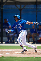 GCL Blue Jays shortstop Leonardo Jimenez (17) follows through on a swing during a game against the GCL Phillies West on August 7, 2018 at Bobby Mattick Complex in Dunedin, Florida.  GCL Blue Jays defeated GCL Phillies West 11-5.  (Mike Janes/Four Seam Images)