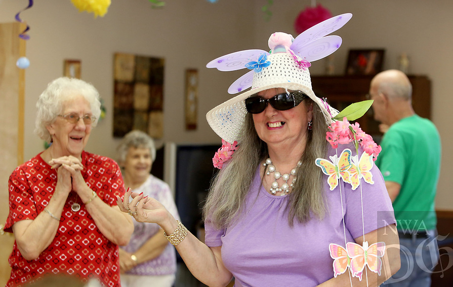 NWA Democrat-Gazette/DAVID GOTTSCHALK  Kat Golden displays her winning entry Easter bonnet Thursday, April 13, 2017, during the bonnet contest at the Farmington Senior Center. The center hosted many Easter themed activities including decorations, an Easter egg hunt and the bonnet contest.
