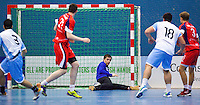 05 APR 2012 - LONDON, GBR - Great Britain goalkeeper Bobby White (GBR) (seated, in purple and black) saves during the 2012 London Cup match against Argentina at the National Sports Centre in Crystal Palace, Great Britain (PHOTO (C) 2012 NIGEL FARROW)