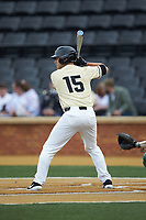 Logan Harvey (15) of the Wake Forest Demon Deacons at bat against the Miami Hurricanes at David F. Couch Ballpark on May 11, 2019 in  Winston-Salem, North Carolina. The Hurricanes defeated the Demon Deacons 8-4. (Brian Westerholt/Four Seam Images)