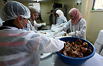 "Palestinians prepare food to be distributed for free during the holy fasting month of Ramadan in the West Bank city of Nablus, on May 11, 2019. The ""Nablus Charity Takiya"", was founded seven years ago providing 1500 meal daily , the workers are volunteers and all food costs are provided by people of Nablus, both rich and poor can get food during the holy fasting month of Ramadan. Photo by Shadi Jarar'ah"