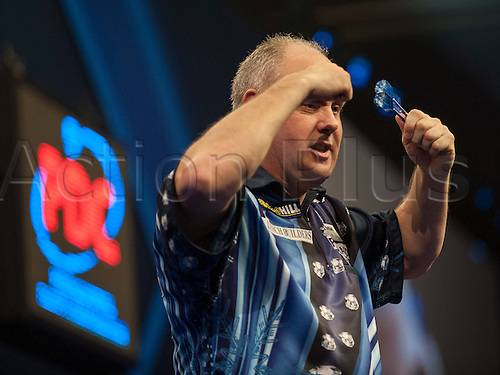 21.12.2014.  London, England.  William Hill PDC World Darts Championship.  Ian White (15) [ENG] celebrates his 3-1 win over qualifier John Michael [GRE].