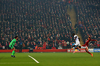 5th November 2019; Anfield, Liverpool, Merseyside, England; UEFA Champions League Football, Liverpool versus Genk; Mbwana Samatta of KRC Genk attempts a shot at goal but sees his effort go wide of Liverpool goalkeeper Alisson's post - Editorial Use