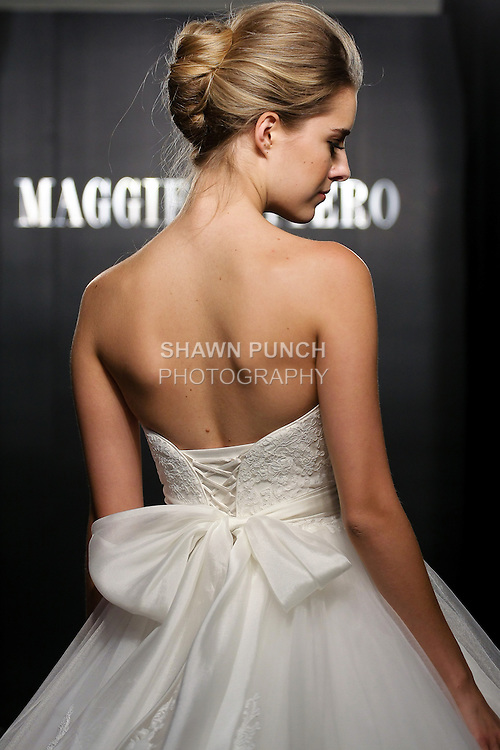 Model walks the runway in an Isabella Leigh wedding dress from the Sottero and Midgley Spring 2012 collection, during  Couture: New York Bridal Fashion Week 2012