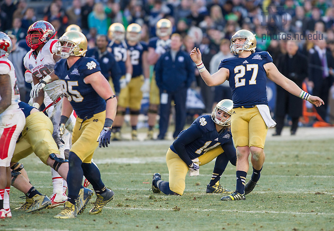 Dec. 28, 2013; Kicker Kyle Brindza (27) and holder Luke Massa (14) watch his 48-yard field goal go through the uprights, sealing the 29-16 win in the Pinstripe Bowl in Yankee Stadium.<br /> <br /> Photo by Matt Cashore