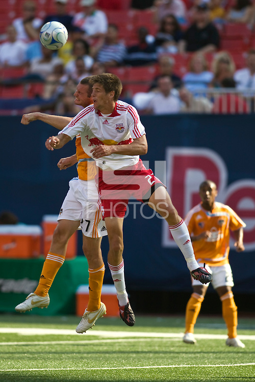 Houston Dynamo forward Nate Jaqua (27) and New York Red Bulls defender Andrew Boyens (27) go up for a header. The New York Red Bulls defeated the Houston Dynamo 3-0 during a Major League Soccer match at Giants Stadium in East Rutherford, NJ, on August 24, 2008.