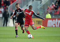 05 May 2012: D.C. United defender Perry Kitchen #23 and Toronto FC foward/midfielder Ryan Johnson #9 in action during an MLS game between DC United and Toronto FC at BMO Field in Toronto..D.C. United won 2-0.