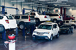 Lefted up cars in a mechanic's shop being serviced and repaired. Auto service center concept.