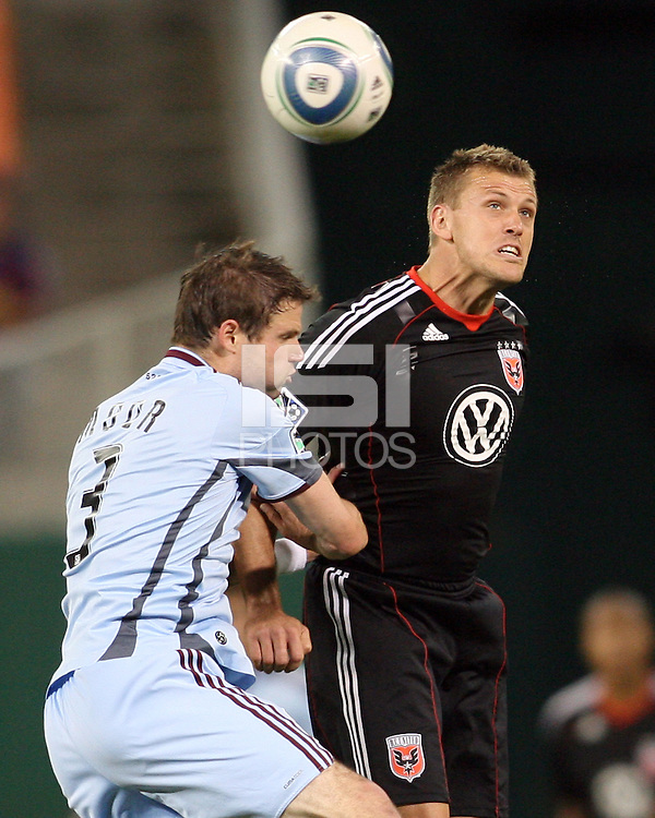 Adam Cristman #7 of D.C. United heads the ball past Drew Moor #3 of the Colorado Rapids during an MLS match on May 15 2010, at RFK Stadium in Washington D.C. Colorado won 1-0.