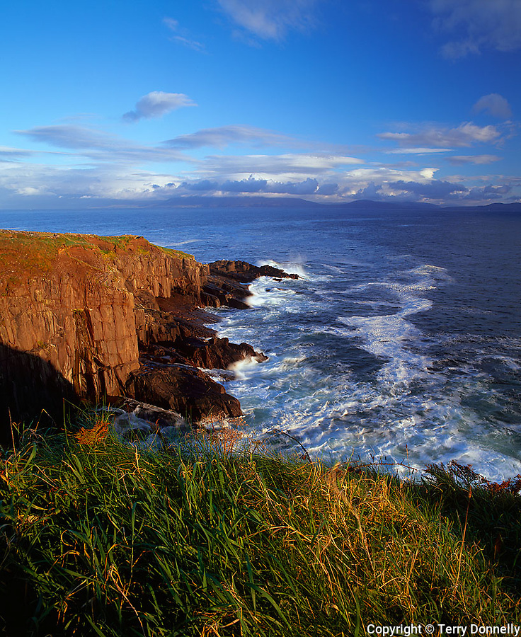 County Kerry, Ireland   <br /> Dingle Bay andsurf under the cliffs of Parkmore Point on the Dingle Peninsula