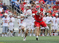 Annapolis, MD - May 20, 2018: Maryland Terrapins Jared Bernhardt (10) gets hit in the face by Cornell Big Red Jake Pulver (34) during the quarterfinal game between Maryland vs Cornell at  Navy-Marine Corps Memorial Stadium in Annapolis, MD.   (Photo by Elliott Brown/Media Images International)