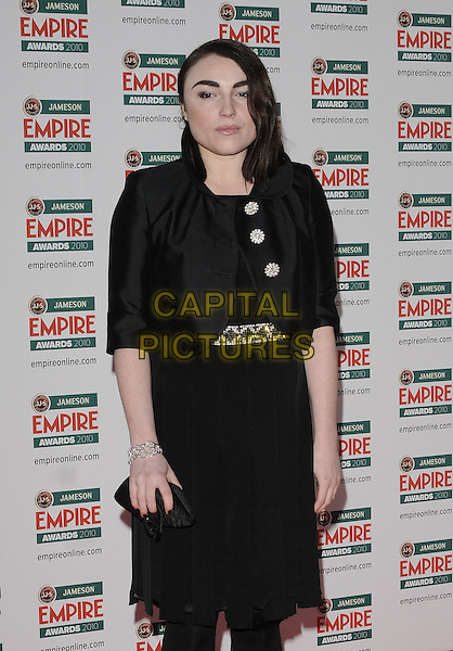 LOIS WINSTONE .At the Jameson Empire Film Awards, Grosvenor House Hotel, Park Lane, London, England, UK, March 28th 2010..Arrivals half length black jacket dress bolero buttons silver clutch bag .CAP/CAN.©Can Nguyen/Capital Pictures