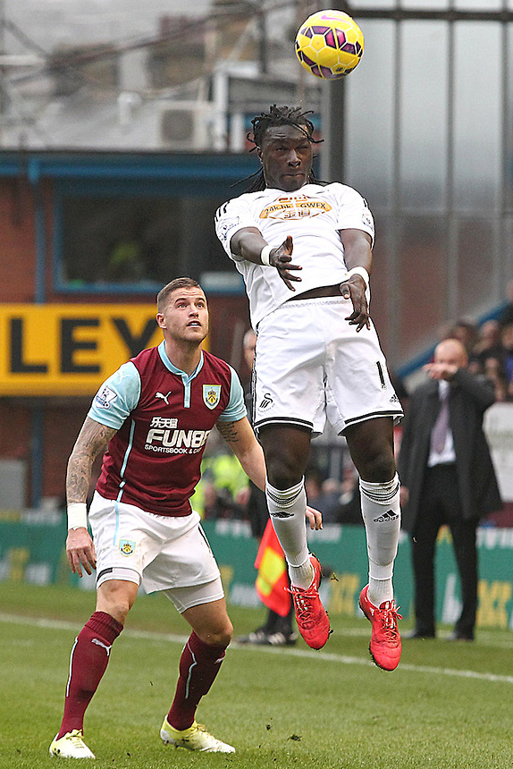 Swansea City's Bafetibis Gomis jumps for an aerial ball<br /> <br /> Photographer Rich Linley/CameraSport<br /> <br /> Football - Barclays Premiership - Burnley v Swansea City - Friday 27th February 2015 - Turf Moor - Burnley<br /> <br /> &copy; CameraSport - 43 Linden Ave. Countesthorpe. Leicester. England. LE8 5PG - Tel: +44 (0) 116 277 4147 - admin@camerasport.com - www.camerasport.com