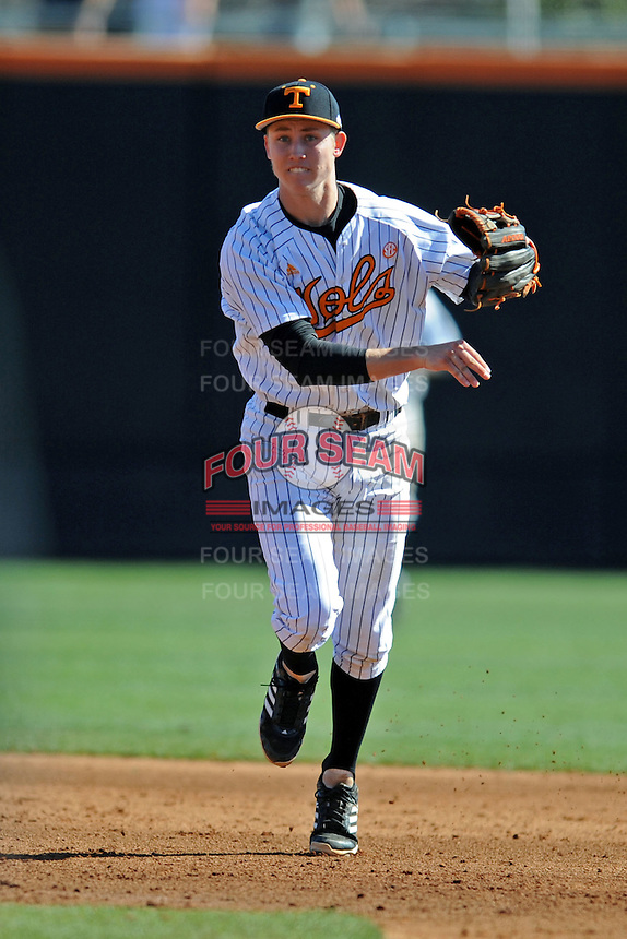 Tennessee Volunteers shortstop A.J. Simcox throws to first during a game against the UNLV Runnin' Rebels at Lindsey Nelson Stadium on February 22, 2014 in Knoxville, Tennessee. The Volunteers defeated the Rebels 5-4. (Tony Farlow/Four Seam Images)