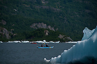 Kayakers and rafters paddle among the icebergs on Spencer Lake.
