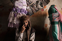 Monday 13 July, 2015: A dressmaker posses for photo in a market place in the Old City of Sana'a, a 2,500-year-old cultural heritage site endangered after a fighter jet of the Saudi-led coalition bombed and destroyed a line of residential tower-houses killing 4 residents and reducing to rubble the historial site. The ongoing aerial campaign of bombardments by the Arab states and their western allies led by Saudi Arabia and the heavy fighting against the entrenchment of the Houthi insurgency along the Yemeni main cities from north to south has caused an international alert for the enlisted cultural heritage sites in Yemen, such as the historic town of Zabid, the Old City of Sana'a and the Old Walled City of Shibam. (Photo/Narciso Contreras)