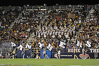 """1 October 2011:  FIU's cheerleaders run with flags spelling """"PANTHERS"""" after a touchdown in the first quarter as the Duke University Blue Devils defeated the FIU Golden Panthers, 31-27, at FIU Stadium in Miami, Florida."""