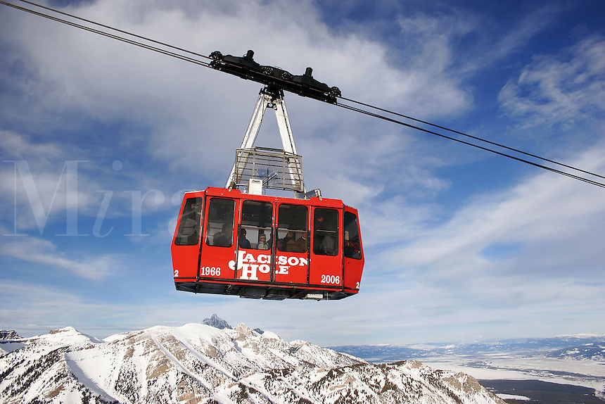 The Jackson Hole Mountain Resort tram in flight over the teton mountain range outside Jackson Wyoming.