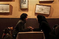 A young couple, unmarried, meet in a cafe in Valiasr Street in central Tehran.
