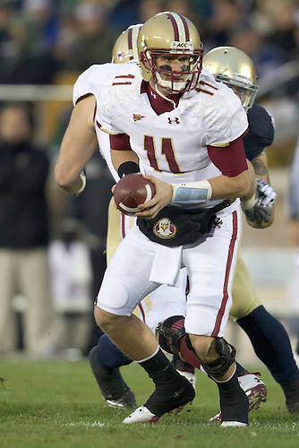 Boston College quarterback Chase Rettig (#11) pivots to hand the ball off during first quarter of NCAA football game between Notre Dame and Boston College.  The Notre Dame Fighting Irish defeated the Boston College Eagles 16-14 in game at Notre Dame Stadium in South Bend, Indiana.