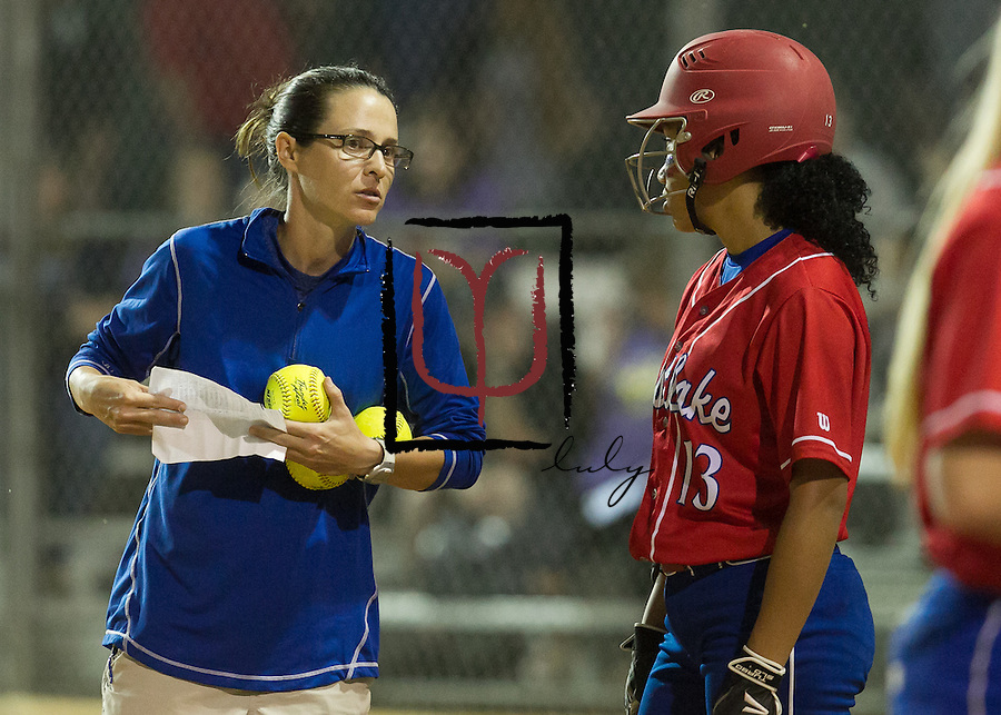 Westlake Head Coach Haley Gaddis talks with Aaliyah Gibson prior to the start against Cedar Ridge in the Region II Bi-District Playoff held at Noack Field Thursday evening.  (LOURDES M SHOAF for Round Rock Leader.)