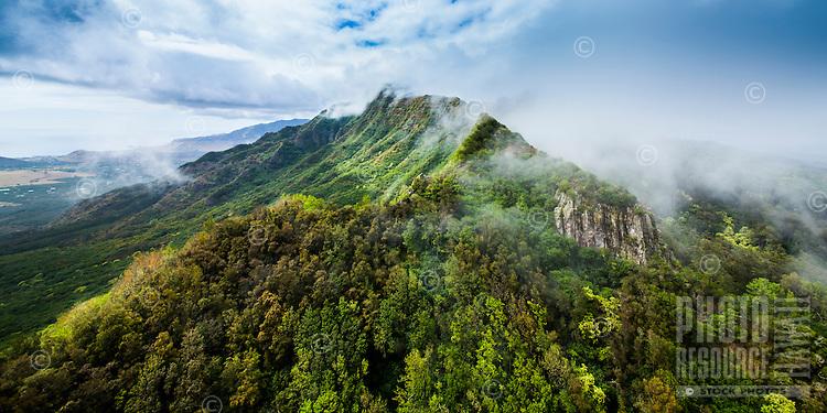 Clouds brush over the Wai'anae Mountains, O'ahu.