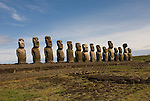 Chile, Easter Island: Array of statues or moai on a platform or ahu at Ahu Tongariki, near the quarry Rano Raruku.  This is the largest array of moia on Easter Island, consisting of 15 moai..Photo #: ch242-32723.Photo copyright Lee Foster www.fostertravel.com lee@fostertravel.com 510-549-2202