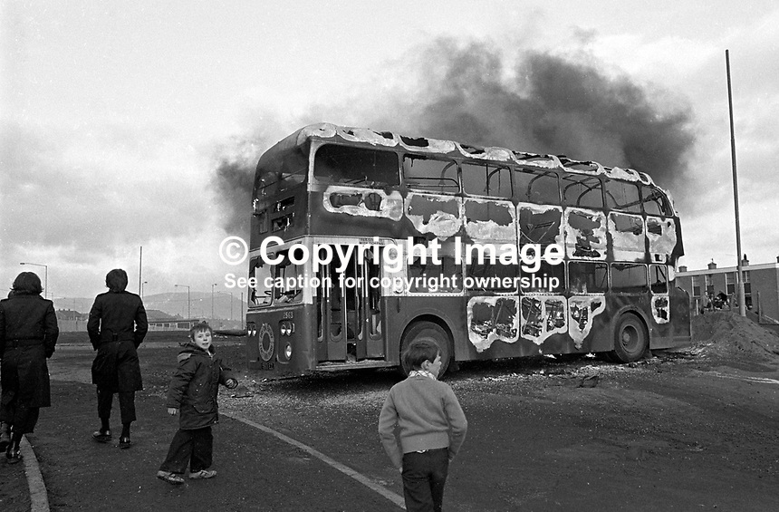 Hijacked bus set on fire blocks a roundabout on Monagh Road, Belfast, N Ireland, during civil disturbances in this staunchly republican area of the city. 197701040031..Copyright Image from Victor Patterson, 54 Dorchester Park, Belfast, UK, BT9 6RJ..Tel: +44 28 9066 1296.Mob: +44 7802 353836.Voicemail +44 20 8816 7153.Skype: victorpattersonbelfast.Email: victorpatterson@me.com.Email: victorpatterson@ireland.com (back-up)..IMPORTANT: If you wish to use this image or any other of my images please go to www.victorpatterson.com and click on the Terms & Conditions. Then contact me by email or phone with the reference number(s) of the image(s) concerned.