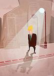 Businessman standing under streetlight