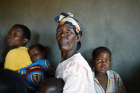 MPHANDULA, MALAWI - AUGUST 20: Maliyaso Notice age 70, attends a church service at the African Abraham Church with her grandchildren on August 20, 2006 in Mphandula village, about 30 miles outside Lilongwe, Malawi. Mphandula is a poor village in Malawi, without electricity or clean water. Nobody owns a car or a mobile phone. Most people live on farming. About 7000 people reside in the village and the chief estimates that there are about five-hundred orphans. Many have been affected by HIV/Aids and many of the children are orphaned. A foundation started by Madonna has decided to build an orphan center in the village through Consol Homes, a Malawi based organization. Raising Malawi is investing about 3 million dollars in the project and Madonna is scheduled to visit the village in October 2006. Malawi is a small landlocked country in Southern Africa without any natural resources. Many people are affected by the Aids epidemic. Malawi is one of the poorest countries in the world and has about 1 million orphaned children. (Photo by Per-Anders Pettersson)