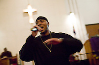 New York, USA - Lamar Hayney, 19, member of the Three Shades of Faith band, raps during mass at the Greater Hood Memorial AME Zion Church, home of the Hip-Hop Church, in Harlem, New York, USA, 3 February 2005. Photo Credit: David Brabyn.