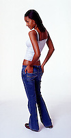 African American girl wearing blue jeans on white seamless<br />