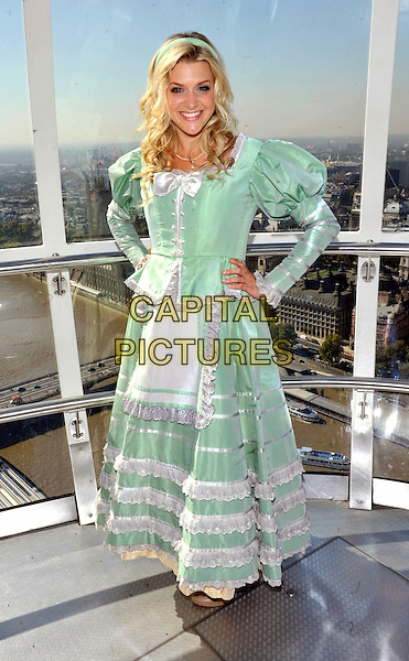 Anna Williamson.Photocall for New Wimbledon Theatre's 2011 Pantomime 'Dick Whittington' held on the London Eye, London, England..September 29th 2011.panto pantomime full length costume dress green hands on hips white.CAP/JIL.©Jill Mayhew/Capital Pictures