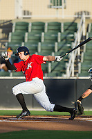 Adam Engel (23) of the Kannapolis Intimidators follows through on his swing against the West Virginia Power at CMC-Northeast Stadium on May 1, 2014 in Kannapolis, North Carolina.  The Power defeated the Intimidators 5-4.  (Brian Westerholt/Four Seam Images)