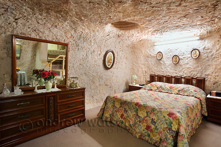 Bedroom in Faye's underground home.  The dugout home was built by three pioneering women in the 1960s using pick and shovel.  Coober Pedy, South Australia, AUSTRALIA.