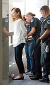 An unidentified demonstrator is arrested by United States Capitol Police in the Hart Senate Office Building as she protests against the Republican bill to replace the Affordable Care Act (ACA), also known as Obamacare, in the United States Senate Office Buildings on Capitol Hill in Washington, DC on Wednesday, July 19, 2017. <br /> Credit: Ron Sachs / CNP<br /> (RESTRICTION: NO New York or New Jersey Newspapers or newspapers within a 75 mile radius of New York City)