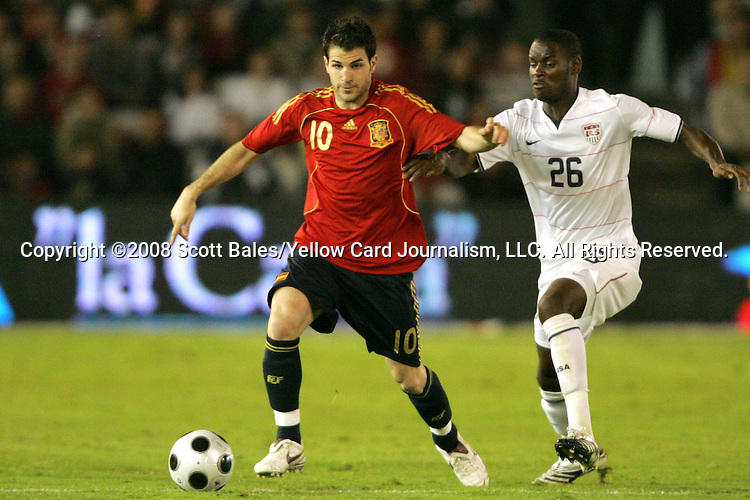 04 June 2008: Cesc Fabregas (ESP) (10) is defended by Maurice Edu (USA) (26). The Spain Men's National Team defeated the United States Men's National Team 1-0 at Estadio Municipal El Sardinero in Santander, Spain in an international friendly soccer match.