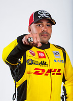 Feb 6, 2020; Pomona, CA, USA; NHRA funny car driver J.R. Todd poses for a portrait with his world championship ring during NHRA Media Day at the Pomona Fairplex. Mandatory Credit: Mark J. Rebilas-USA TODAY Sports