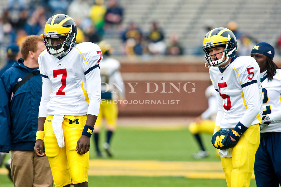 Michigan quarterback Devin Gardner (7) and quarterback Tate Forcier (5) watch teammates run through warm up drills before the Wolverines' spring football game, Saturday, April 17, 2010, in Ann Arbor, Mich. (AP Photo/Tony Ding)