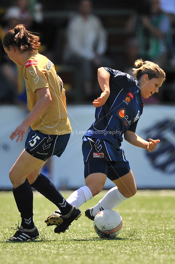 MELBOURNE, AUSTRALIA - OCTOBER 31: Katrina GORRY from Melbourne Victory is tackled in round 5 of the Westfield W-league match between Melbourne Victory and Newcastle Jets at the Veneto Club on October 31, 2009 in Melbourne, Australia. Photo Sydney Low www.syd-low.com
