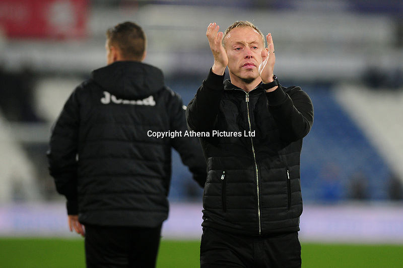 Steve Cooper Head Coach of Swansea City applauds the fans at the final whistle during the Sky Bet Championship match between Huddersfield Town and Swansea City at The John Smith's Stadium in Huddersfield, England, UK. Tuesday 26 November 2019