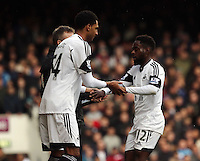 Pictured L-R: David N'Gog of Swansea substituting Nathan Dyer. 01 February 2014<br /> Re: Barclay's Premier League, West Ham United v Swansea City FC at Boleyn Ground, London.