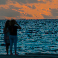 Four Seasons,Kuda Huraa, Maldives (Saturday, August 15, 2015) A green flash as the sun set tonight. The surf was still in the 4'-6' range today from the South South East today with very clean conditions.  There was a session at the famed 'Sultans Point' in the afternoon.  The wind was light from the North West.   Photo: joliphotos.com