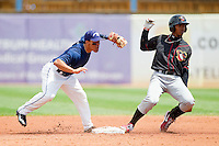 Teoscar Hernandez (4) of the Quad Cities River Bandits slides into second base ahead of the tag by shortstop David Gonzalez (18) of the West Michigan Whitecaps at Fifth Third Ballpark on May 5, 2013 in Comstock Park, Michigan.  The River Bandits defeated the Whitecaps 5-4.  (Brian Westerholt/Four Seam Images)