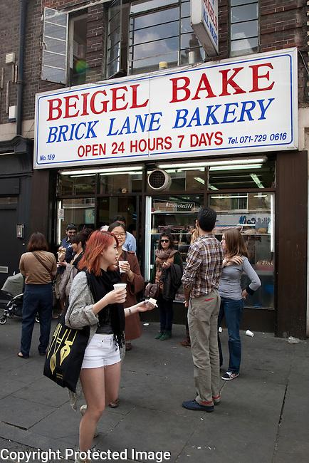 Customers outside Beigel Bake, Brick Lane Bakery in London, England, UK