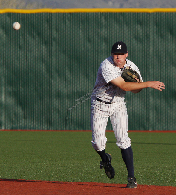 Nevada second baseman Joe Kohan throws to first against Fresno.  Photo by Tom Smedes.