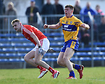 Kieran Malone of Clare celebrates his goal as Gerard Mc Sorley of Louth looks goalward during their national League game in Cusack Park. Photograph by John Kelly.
