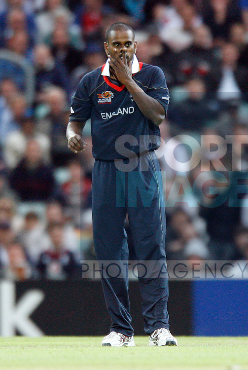 England's Dimitri Mascarenhas looks on after getting hit for four
