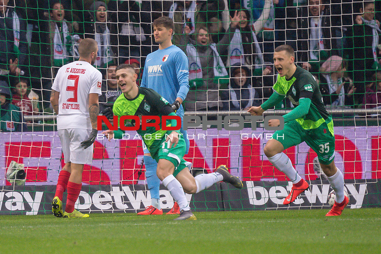 10.02.2019, Weser Stadion, Bremen, GER, 1.FBL, Werder Bremen vs FC Augsburg, <br /> <br /> DFL REGULATIONS PROHIBIT ANY USE OF PHOTOGRAPHS AS IMAGE SEQUENCES AND/OR QUASI-VIDEO.<br /> <br />  im Bild<br /> <br /> 1:0 Milot Rashica (Werder Bremen #11) gegen Gregor Kobel (FC Augsburg #40)<br /> Konstantinos Stafylidis (FC Augsburg #03)<br /> Rani Khedira (FC Augsburg #08)<br /> Maximilian Eggestein (Werder Bremen #35)<br /> <br /> jubel <br /> Foto &copy; nordphoto / Kokenge