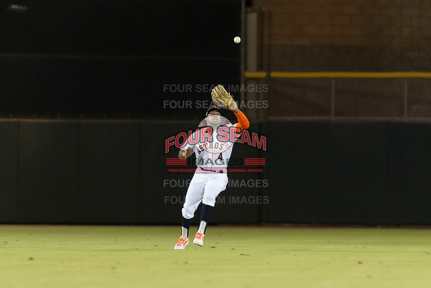 Scottsdale Scorpions center fielder Ronnie Dawson (4), of the Houston Astros organization, prepares to catch a fly ball during an Arizona Fall League game against the Surprise Saguaros at Scottsdale Stadium on October 15, 2018 in Scottsdale, Arizona. Surprise defeated Scottsdale 2-0. (Zachary Lucy/Four Seam Images)